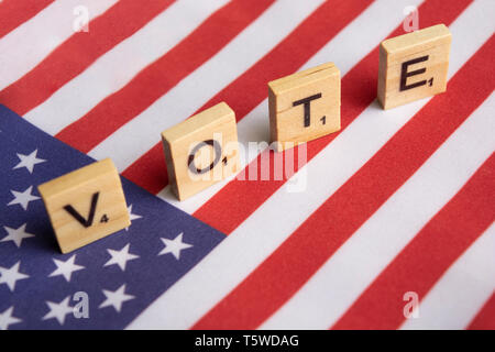 Maski, India 26, April 2019 : Vote wooden block letters on US flag - Stock Photo