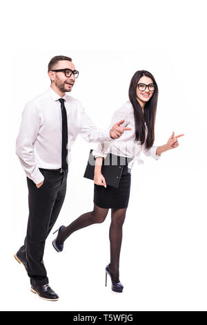 Happy couple running away isolated over gray background, - Stock Photo
