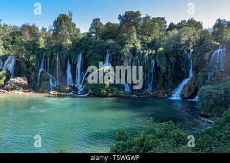 Bosnia and Herzegovina, Kravica Waterfalls - June 2018: Popular with tourists Kravica waterfall is a large tufa cascade on the Trebižat River, in the  - Stock Photo