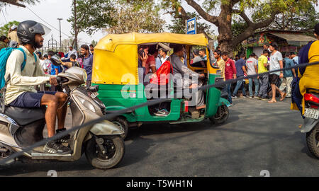 Driving in Delhi - heavy traffic  is the norm with tuk-tuks, cars, motorbikes, lorries and pedestrians competing for space - shot from a car window - Stock Photo