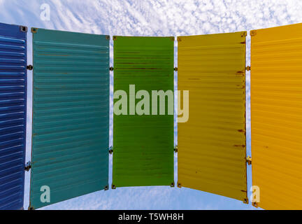 A series of colorful panels against the blue sky with white clouds, Fremantle, Western Australia - Stock Photo