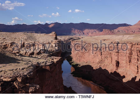View of the Colorado River at Marble Canyon beside the Vermilion Cliffs, Arizona, at sunset - Stock Photo