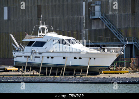 motor yacht in dockyard for maintenance - Stock Photo