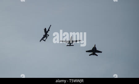 Two A-10 Thunderbolt IIs, from the 190th Fighter Squadron, Boise, Idaho, and an F-18 Super Hornet, based ashore at Naval Air Station Oceana, Virginia Beach, Virginia fly in formation after a training sortie south of Gowen Field, Boise, Idaho on April 25, 2019. The aircraft have been training hand in hand at the Mountain Home Range Complex, Idaho. (U.S. Air National Guard photo by Master Sgt. Joshua C. Allmaras) - Stock Photo