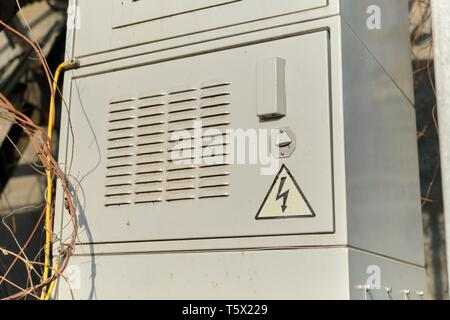 Gray steel electrical switchboard panel enclosures outdoor. - Stock Photo