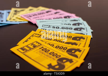 'RAK, RAK, UAE - 4/20/2019 : Colourful Game of Life  Money fanned out on the table. Family fun for all ages strategizing and having fun with this Milt - Stock Photo