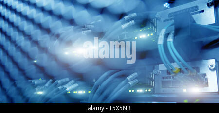 Close up fiber optic and hub in server room - Stock Photo