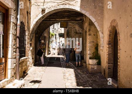 Street of historic hilltop village near Nice in France. - Stock Photo