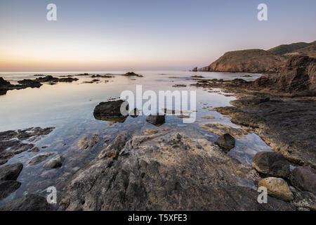 Sunrise on the coast of Escullos. Natural Park of Cabo de Gata. Spain. - Stock Photo