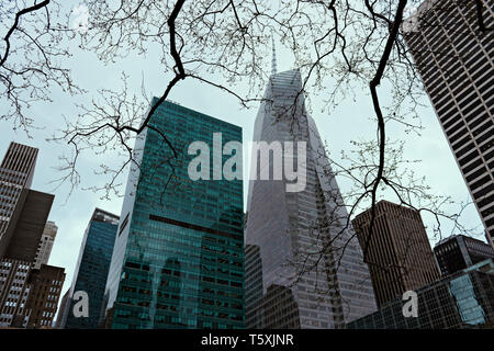 Buildings on Sixth Avenue at Bryant Park, including the Bank of America Tower (aka One Bryant Park). Midtown Manhattan, New York City, USA. - Stock Photo
