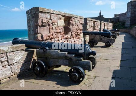 Canons on Battery Terrace at Bamburgh Castle, Northumberland, England, UK Stock Photo
