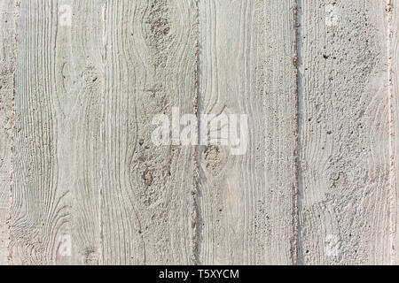 Concrete with a texture of wooden boards. - Stock Photo