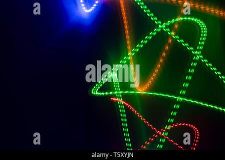Abstract glowing  neon lines on black background.  - Stock Photo