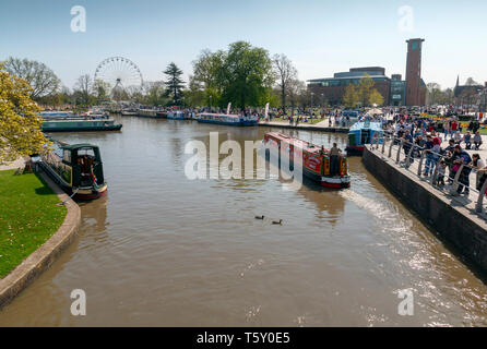 Stratford upon Avon, Warwickshire, UK - April 19, 2019: View from a canal bridge in Stratford upon Avon with Royal Shakespeare theatre and big wheel o - Stock Photo