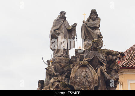 Baroque Statues on the Prague Charles Bridge on a sunny day. - Stock Photo