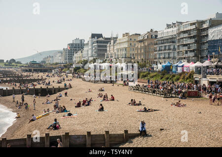 holiday crowds enjoying drinks and food at an outside  beach café on the promenade at Eastbourne seaside resort south east Sussex England UK - Stock Photo