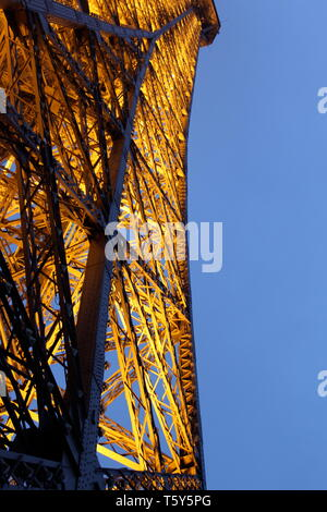 View of the Eiffel tower in Paris lit up at night - Stock Photo