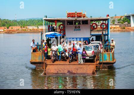 GOA, INDIA - NOVEMBER 06, 2011: Local ferry boat crossing Terekhol river from Maharashtra to Goa in India - Stock Photo