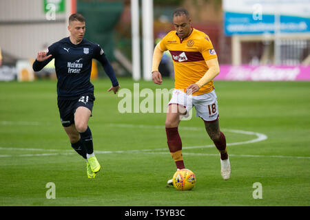 Fir Park, Motherwell, UK. 27th Apr, 2019. Ladbrokes Premiership football, Motherwell versus Dundee; Charles Dunne of Motherwell and Andrew Nelson of Dundee Credit: Action Plus Sports/Alamy Live News - Stock Photo