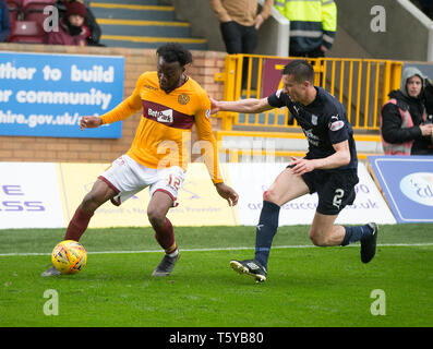 Fir Park, Motherwell, UK. 27th Apr, 2019. Ladbrokes Premiership football, Motherwell versus Dundee; Gboly Ariyibi of Motherwell and Cammy Kerr of Dundee Credit: Action Plus Sports/Alamy Live News - Stock Photo