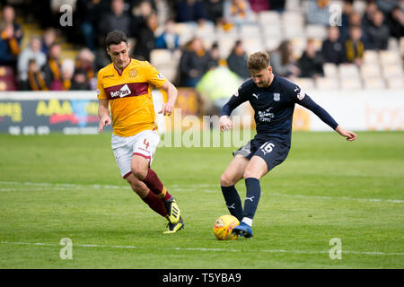 Fir Park, Motherwell, UK. 27th Apr, 2019. Ladbrokes Premiership football, Motherwell versus Dundee; Ethan Robson of Dundee and Carl McHugh of Motherwell Credit: Action Plus Sports/Alamy Live News - Stock Photo