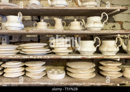 ceramic teapot and moulds on a shelf at Gladstone Pottery Museum Stoke on Trent - Stock Photo