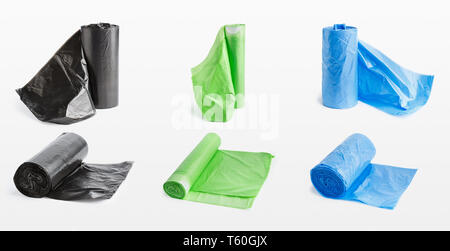 Garbage bags rolls on white - Stock Photo