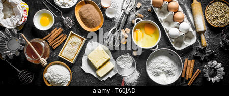 Baking background. Flour and various ingredients for dough. Top view - Stock Photo