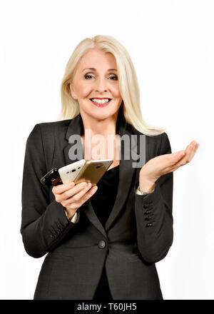 Attractive business woman holding multiple mobile phones with hand up in  a resigned look - Stock Photo