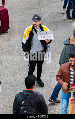 CENTRAL STATIONS, MUNICH, APRIL 6, 2019: borussia dortmund fan looking for tickets for a soccer game. - Stock Photo