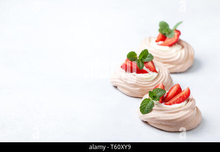 pavlova chocolate mini cakes with strawberries close-up - Stock Photo