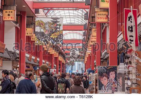 Asakusa, Tokyo, Japan - March 17, 2019: People visiting shopping street near Senso-ji Temple , famous temple in Tokyo,Japan - Stock Photo