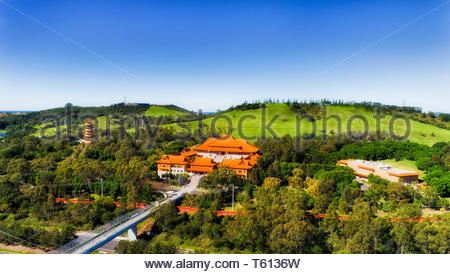 Monastery complex of Nan Tien temple with traditional chinese style architecture building and high pagoda tower - Buddhist religion under blue sky of  - Stock Photo