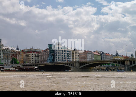 Prague, Czech Republic - May 8, 2012:   View to  famous Dancing House in Prague from River Vltava,  Czech Republic Stock Photo