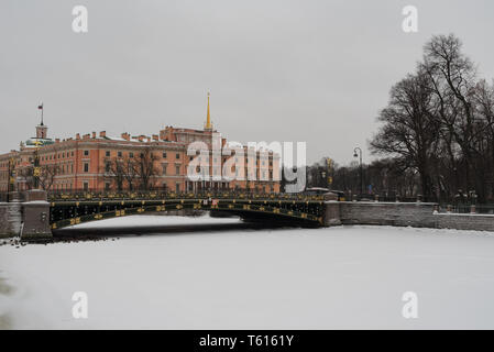 The facade of the Mikhailovsky (engineers') castle and the river Moika in Saint-Petersburg, Russia - Stock Photo