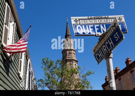 Signs for Church Street and Queen Street in Charleston, South Carolina, USA. The spire of St Philip's Church is seen in the background. - Stock Photo