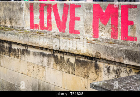 Message of love written on the wall - Stock Photo