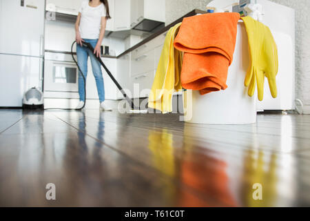 professional home cleaning. A young woman cleans the apartment. Close-up, rags, sponges and bucket, supplies staff - Stock Photo