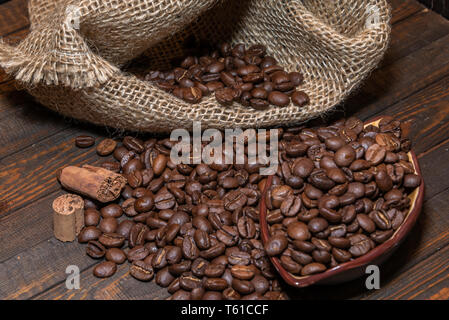 Coffee beans out of the bag - Stock Photo