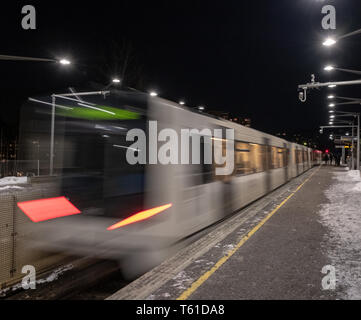 Commuting with subway at night in Oslo - Stock Photo