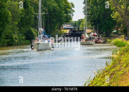 Sailboats at a lock on the Gota canal a beautiful sunny summer day - Stock Photo