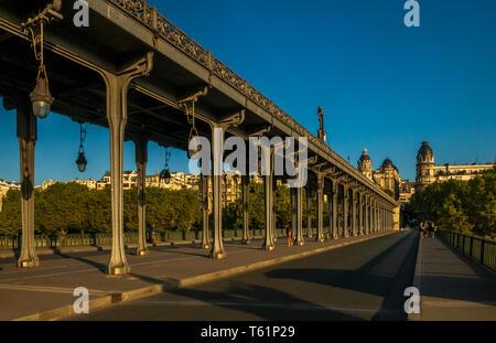 Paris, France, August 19,2018: View of pont de Bir-Hakeim (formerly pont de Passy) - a bridge that crosses the Seine River. Central arch decorated wit - Stock Photo