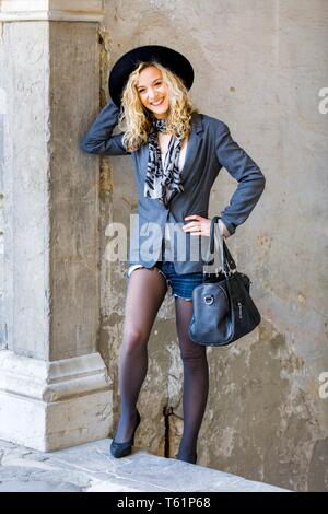Teen girl charm charming retro clothing wearing hat leg exposed showing charm charming - Stock Photo