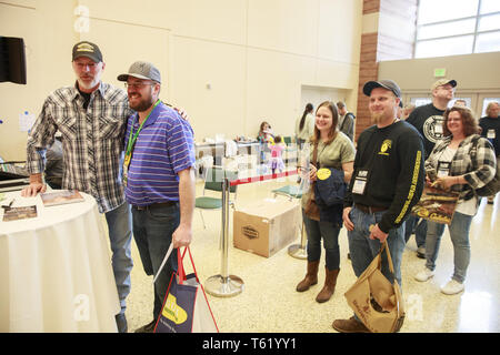 Indianapolis, Indiana, UK. 27th Apr, 2019. Country music star Darryl Worley signs autographs and poses for pictures with his fans after performing during the third day of the National Rifle Association convention. Credit: Jeremy Hogan/SOPA Images/ZUMA Wire/Alamy Live News - Stock Photo
