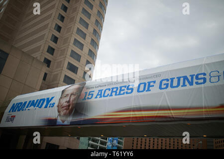 Indianapolis, Indiana, UK. 27th Apr, 2019. A photo of NRA Chief Executive and Executive Vice President Wayne LaPierre is displayed on the Indiana Convention Center during the third day of the National Rifle Association convention. Credit: Jeremy Hogan/SOPA Images/ZUMA Wire/Alamy Live News - Stock Photo