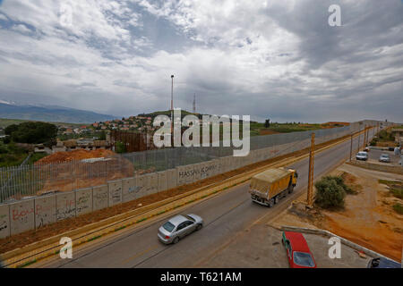 Beirut, Lebanon. 27th Apr, 2019. Vehicles run alongside the separation wall along the border with Israel, in southern Lebanon, April 27, 2019. Israel's construction of a wall along its border with Lebanon is a contentious issue between the two countries. Credit: Bilal Jawich/Xinhua/Alamy Live News - Stock Photo