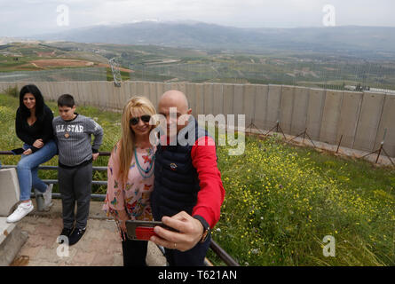 Beirut, Lebanon. 27th Apr, 2019. Lebanese take selfies with the separation wall along the border with Israel, in southern Lebanon, April 27, 2019. Israel's construction of a wall along its border with Lebanon is a contentious issue between the two countries. Credit: Bilal Jawich/Xinhua/Alamy Live News - Stock Photo