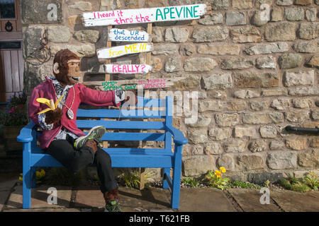 """Wray, Lancaster, UK. 28th April, 2019. The Scarecrow Festival with creatures, characters, caricatures, figures, animals, using plastics, bottles, containers,  wrapping and containers. The 2019 theme, chosen by the local school, is to highlight the themes of """"Evolution: Extinct, Endangered, Existing"""" This fun festive community event the annual Wray Scarecrow Festival in Lancashire is now in its 26th year and draws thousands of visitors to the rural village for the April celebration. Credit: MediaWorldImages/Alamy Live News - Stock Photo"""