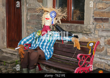 "Wray, Lancaster, UK. 28th April, 2019. Best in show at the Scarecrow Festival with creatures, characters, caricatures, figures, animals, using plastics, bottles, containers,  wrapping and containers. The 2019 theme, chosen by the local school, is to highlight the themes of ""Evolution: Extinct, Endangered, Existing"" This fun festive community event the annual Wray Scarecrow Festival in Lancashire is now in its 26th year and draws thousands of visitors to the rural village for the April celebration. Credit: MediaWorldImages/Alamy Live News - Stock Photo"