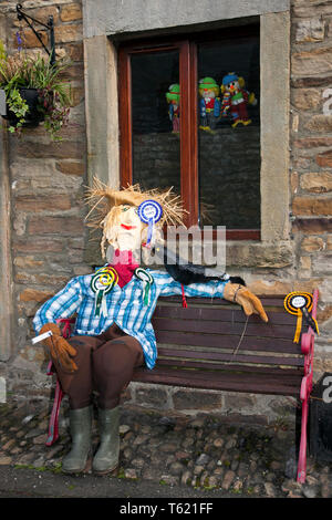 """Wray, Lancaster, UK. 28th April, 2019. Best in show at the Scarecrow Festival with creatures, characters, caricatures, figures, animals, using plastics, bottles, containers,  wrapping and containers. The 2019 theme, chosen by the local school, is to highlight the themes of """"Evolution: Extinct, Endangered, Existing"""" This fun festive community event the annual Wray Scarecrow Festival in Lancashire is now in its 26th year and draws thousands of visitors to the rural village for the April celebration. Credit: MediaWorldImages/Alamy Live News - Stock Photo"""